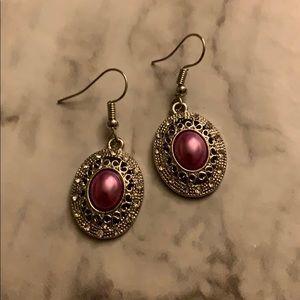 Women's silver tone earrings with purple stone